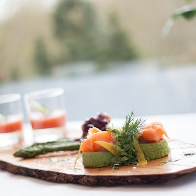 Snack with smoked salmon on wood board Restaurant Rotisserie Hotel des Nordens